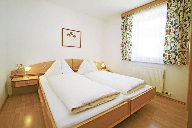 Schlafzimmer - Ferienwohnungen in Flachau, Ferienwohnung Bergkristall, Appartements Dertnig