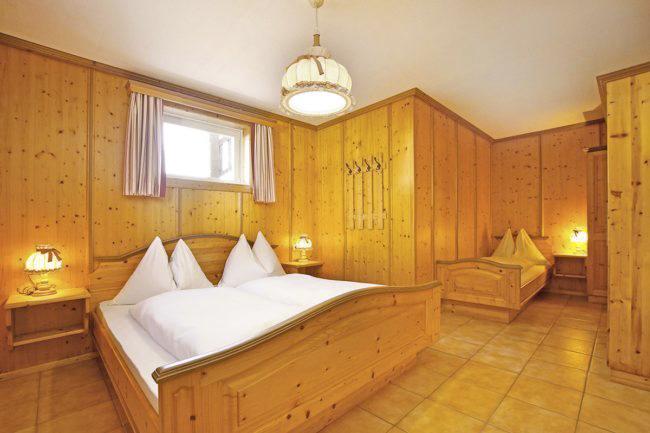 Schlafzimmer - Ferienwohnung Edelweiß, Flachau